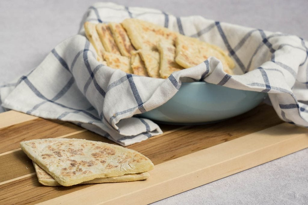 Traditional Scottish Tattie Scones Recipe presented on chopping board and bowl