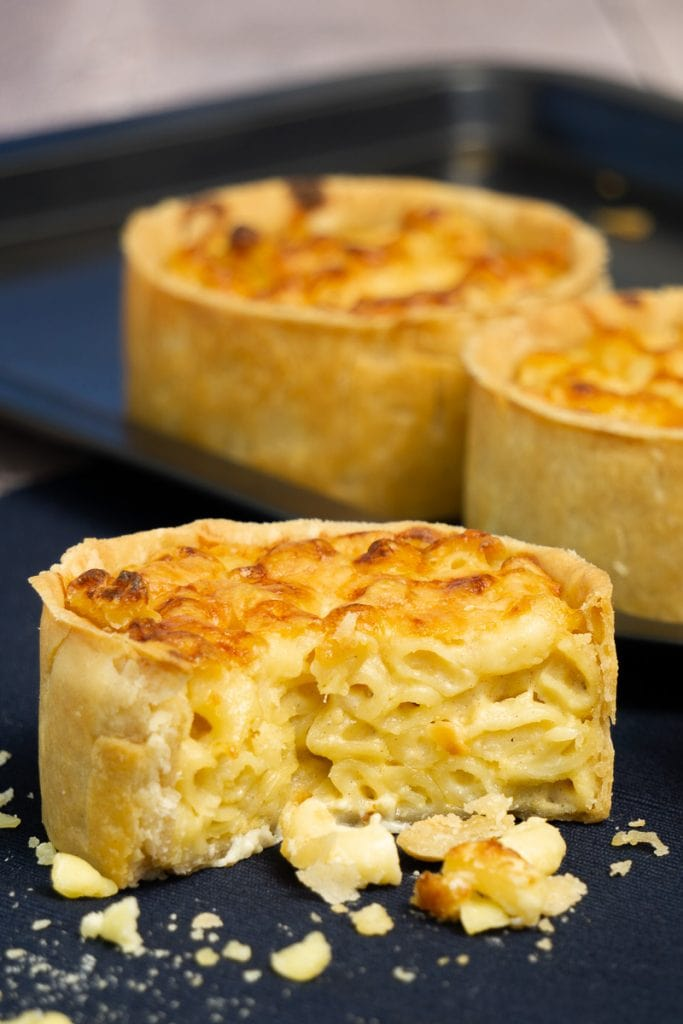 Scottish Macaroni Pie on cloth with pies in the background
