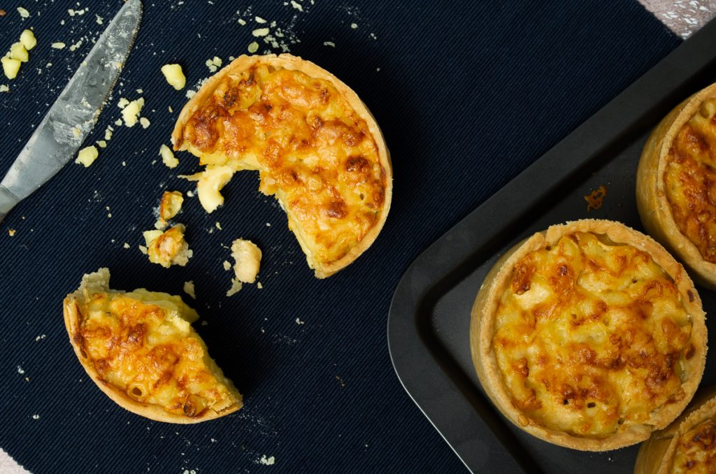 Scotch macaroni Pie Recipe - Pies on tray and one cut on mat