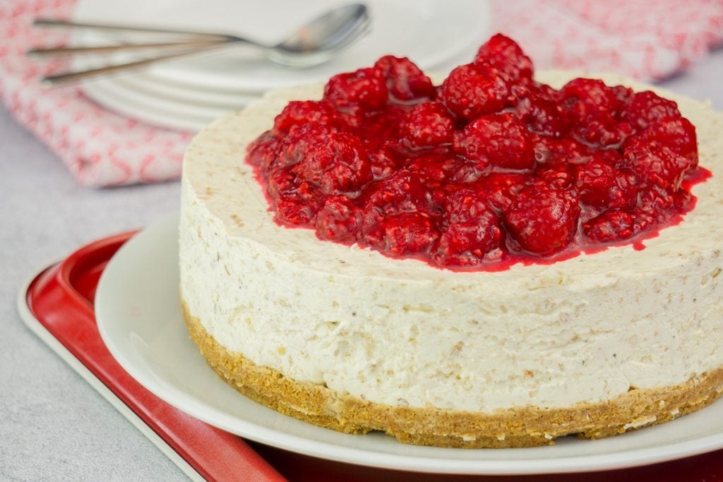 Cranachan Cheesecake Recipe - Cranachan Cheesecake on a plate topped with raspberries