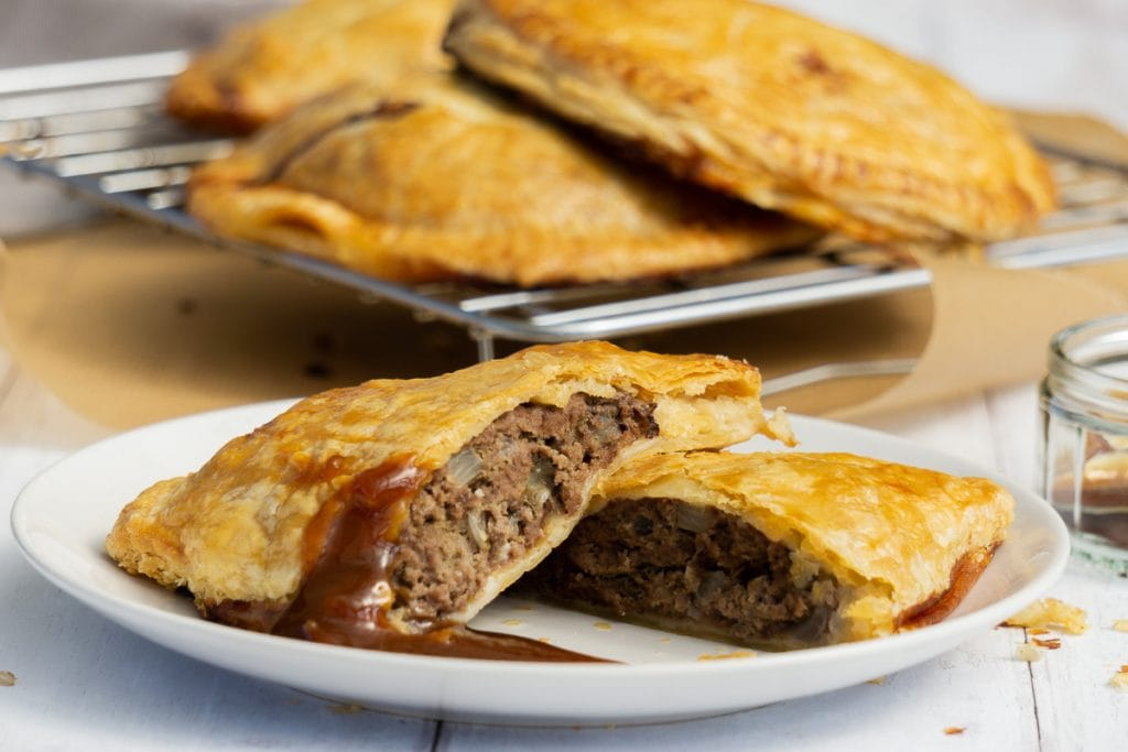 Forfar Bridie on a plate with brown sauce