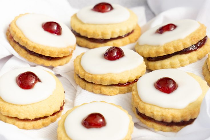 How to Make Empire Biscuits Recipe - Double Shortbread Biscuits sandwiched with jam, iced and topped with a cherry