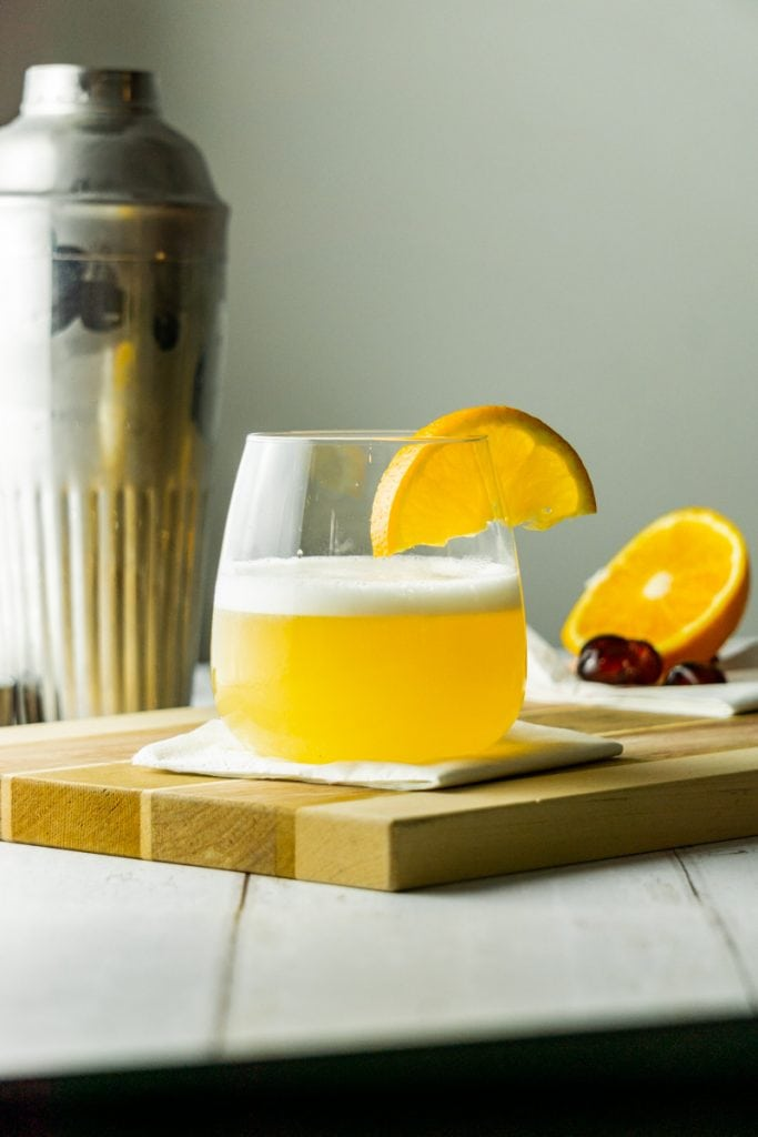 A Whisky Sour with cocktail shaker