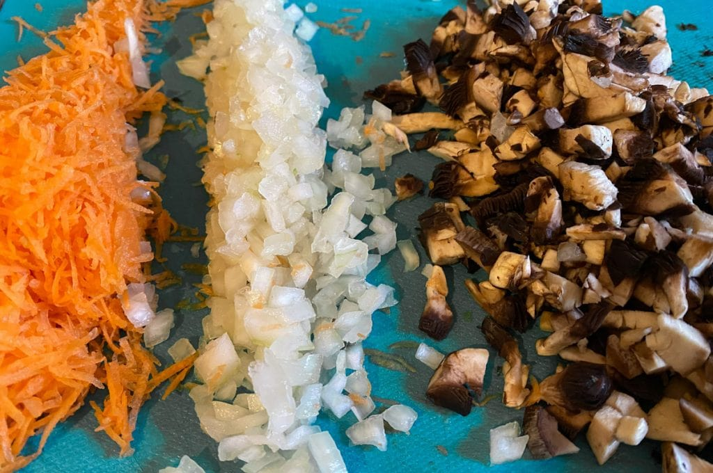 Chopped carrot, onion, and mushroom ready for vegetarian haggis recipe