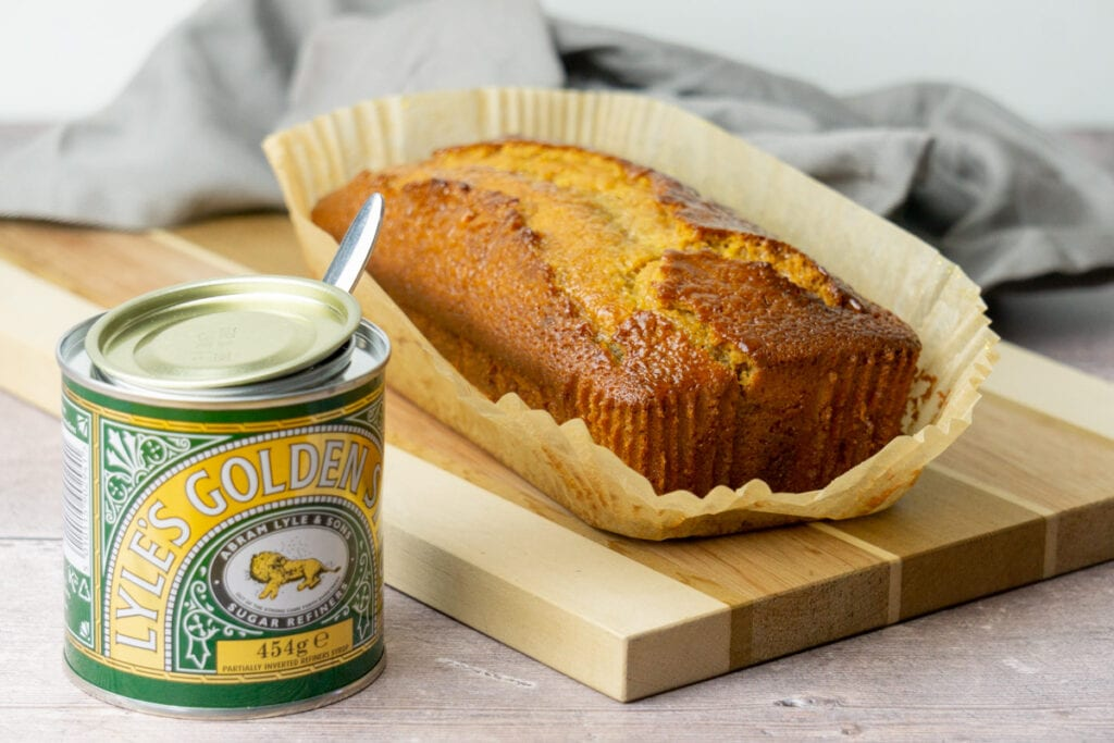 Golden Syrup Cake next to tin of Golden Syrup